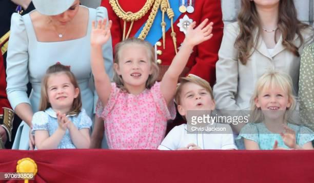 Princess Charlotte of Cambridge Savannah Phillips Prince George of Cambridge and Isla Phillips watch the flypast on the balcony of Buckingham Palace...