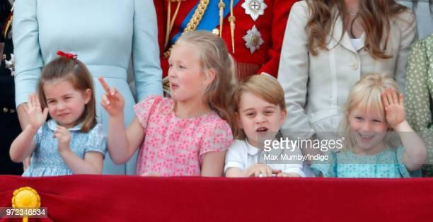 Princess Charlotte of Cambridge Savannah Phillips Prince George of Cambridge and Isla Phillips stand on the balcony of Buckingham Palace during...