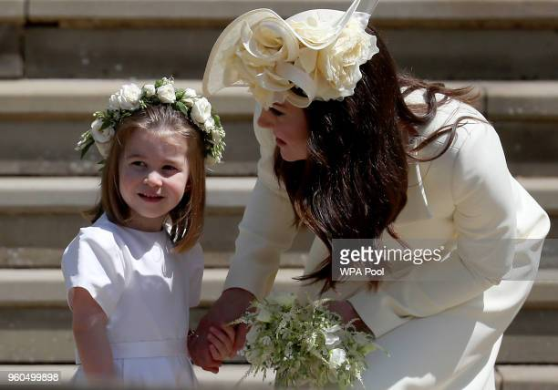 Princess Charlotte of Cambridge stands on the steps with her mother Catherine Duchess of Cambridge after the wedding of Prince Harry and Ms Meghan...
