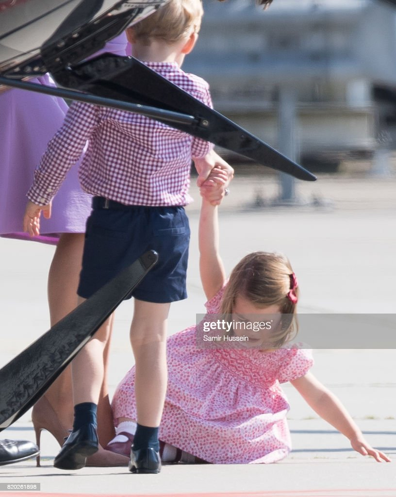 Princess Charlotte of Cambridge takes a fall as she departs from Hamburg airport on the last day of their official visit to Poland and Germany on July 21, 2017 in Hamburg, Germany.