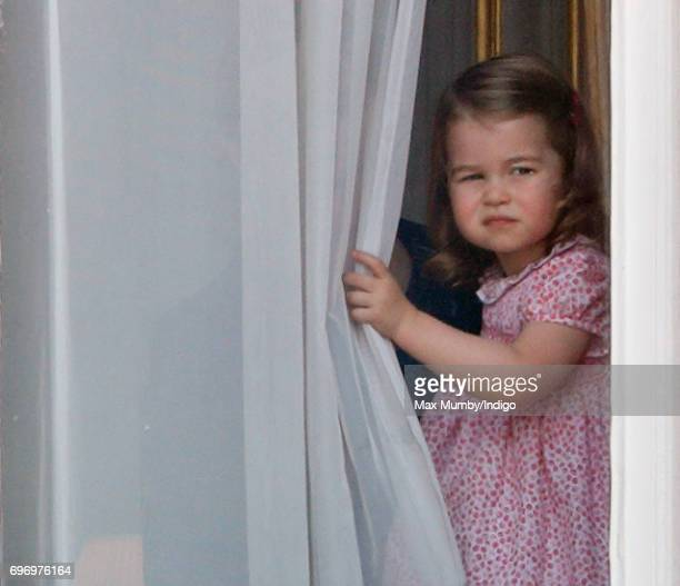 Princess Charlotte of Cambridge watches from a window of Buckingham Palace during the annual Trooping the Colour Parade on June 17 2017 in London...