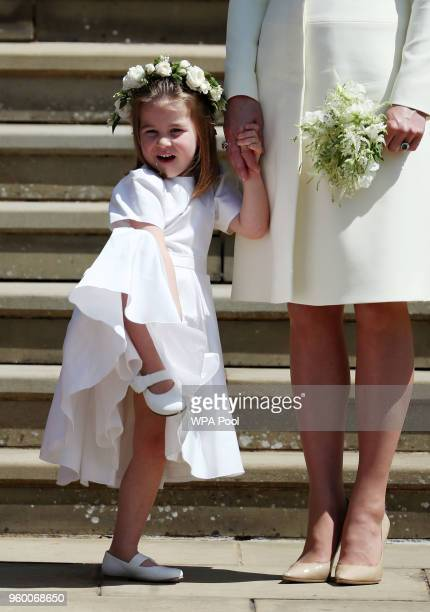 Princess Charlotte on the steps of St George's Chapel after the wedding of Prince Harry and Meghan Markle in St George's Chapel at Windsor Castle on...