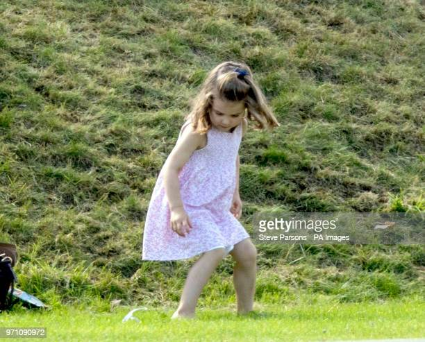 Princess Charlotte plays as her father the Duke of Cambridge takes part in the Maserati Royal Charity Polo Trophy at the Beaufort Polo Club Downfarm...