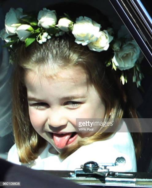 Princess Charlotte rides in a car to the wedding of Prince Harry and Meghan Markle at St George's Chapel in Windsor Castle on May 19 2018 in Windsor...