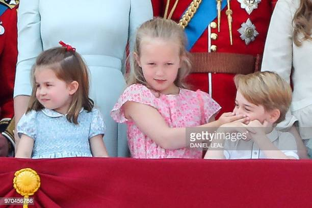 Princess Charlotte Savannah Phillips and Prince George stand on the balcony of Buckingham Palace to watch a flypast of aircraft by the Royal Air...