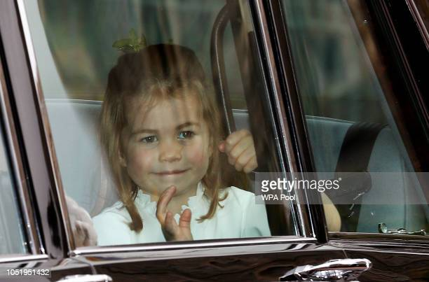 Princess Charlotte waves as she arrives by car for the wedding of Princess Eugenie of York and Jack Brooksbank in St George's Chapel Windsor Castle...