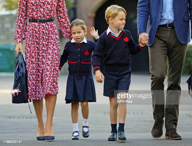 Princess Charlotte, waves as she arrives for her first day at school, with her brother Prince George and her parents the Duke and Duchess of...
