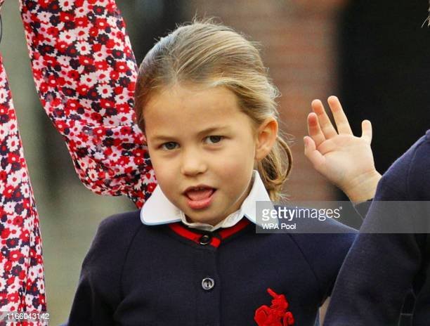 Princess Charlotte waves as she arrives for her first day of school at Thomas's Battersea in London accompanied by her brother Prince George and her...