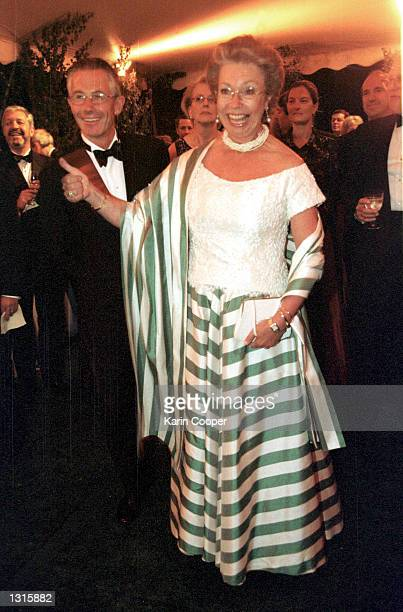 Princess Christina of Sweden jokes during the annual Opera Ball June 8 2001 at the Swedish Embassy in Washington DC At left is Tord Magnuson Princess...