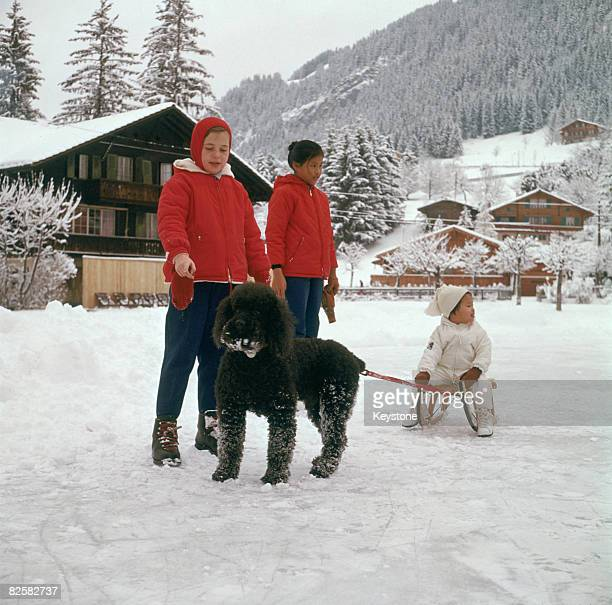 Princess Chulabhorn the youngest daughter of King Bhumobol and Queen Sirikit of Thailand sitting on a sledge during a skiing holiday in Gstaad...
