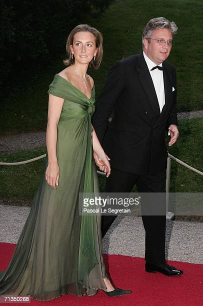 Princess Claire of Belgium and Prince Laurent of Belgium pose as they arrive to attend a royal dinner that is part of the Grand Duke Henri of...