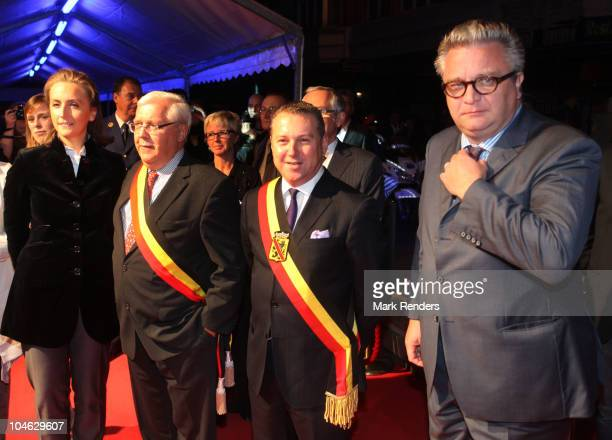 Princess Claire of Belgium, Mayor Jacques Etienne, Governor Dennis Mathen and Prince Laurent of Belgium pose for a photo during the opening night of...