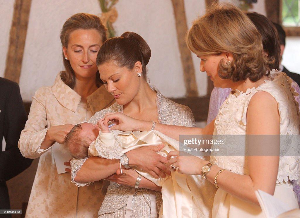 Princess Claire of Belgium, Princess Victoria of Sweden holding Princess Eleonore of Belgium and Princess Mathilde of Belgium during the baptism of Princess Eleonore at the Chapel of Ciergnon Castle on June 14, 2008 in Ciergnon, Belgium.