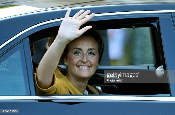 Princess Claire of Belgium waves to the crowd during the Abdication Of King Albert II Of Belgium & Inauguration Of King Philippe at the Cathedral of...