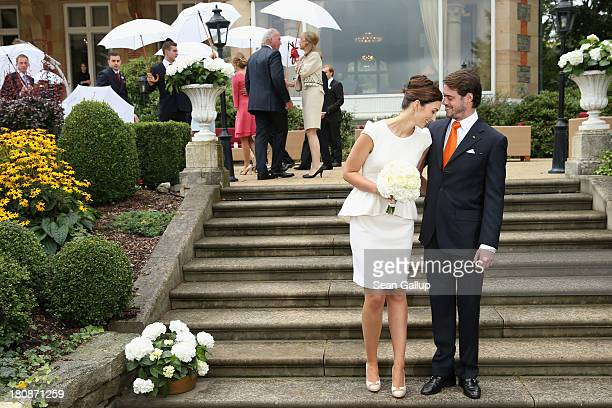 Princess Claire of Luxembourg and Prince Felix Of Luxembourg pose for photographer after taking their vows at their Civil Wedding Ceremony at Villa...