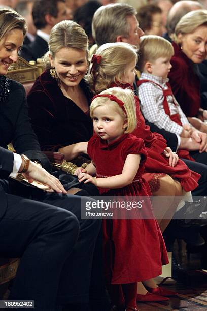 Princess Claire, Princess Mathilde and Princess Louise of Belgium attend the Xmas concert at the Royal Palace on December 20, 2006 in Brussels,...