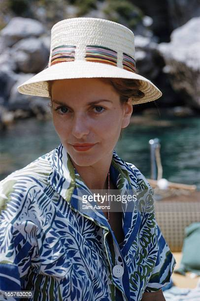 Princess Colonna posing wearing a Panamastyle hat with a blue white and green blouse on the island of Capri Italy in July 1958