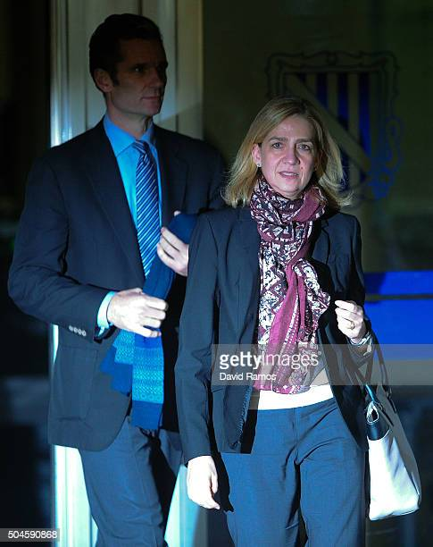 Princess Cristina de Borbon and her husband Inaki Urdangarin leave the courtroom at the Balearic School of Public Administration for summary...