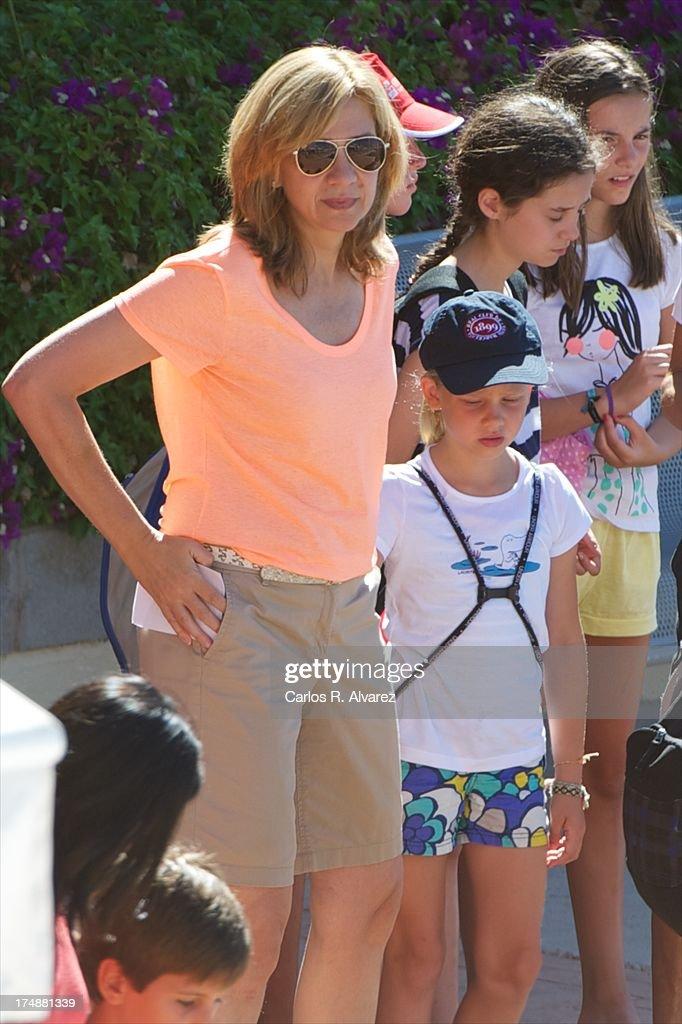 Princess Cristina of Spain and her daugther Irene Urdangarin arrive at Calanova Sailing School on July 29, 2013 in Palma de Mallorca, Spain.