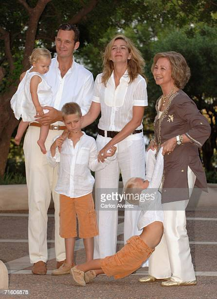 Princess Cristina of Spain with husband Inaki Urdangarin Queen Sofia and sons Irene Juan Valentin and Miguel attend a photocall during their summer...