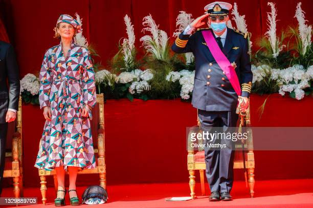 Princess Delphine and Prince Laurent of Belgium attend the ceremony in front of the Royal Palace on the occasion of the National Day on July 21, 2021...