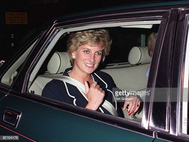 Princess Diana Adjusting Her Seat Belt As She Leaves The Hilton Hotel By Car After Attending A Charity Lunch