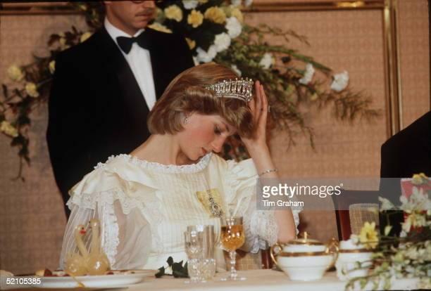 Princess Diana Adjusting Her Tiara During A Banquet In New Zealand