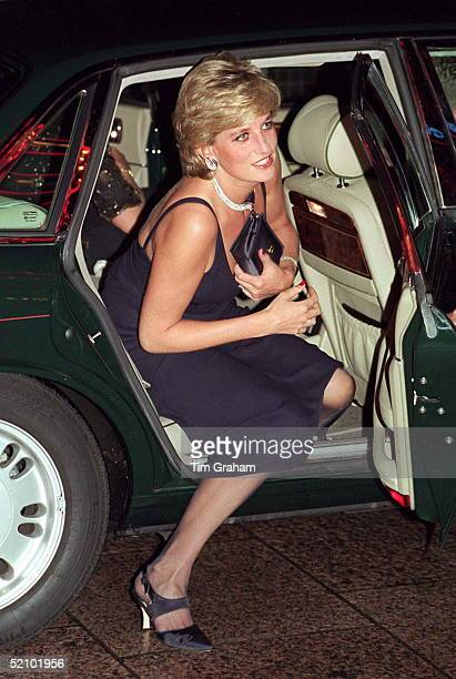 Princess Diana Alighting Her Car At The Premiere Of The Film 'haunted' At The Empire Cinema In London. The Princess Is Wearing A Blue Evening Dress...