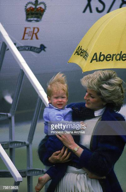 Princess Diana and a young Prince Harry in the rain at Aberdeen airport September 1985