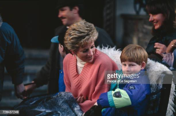 Princess Diana and her sons Prince Harry and Prince William prepare to take a ride in a horsedrawn sleigh during a holiday in the Austrian resort of...