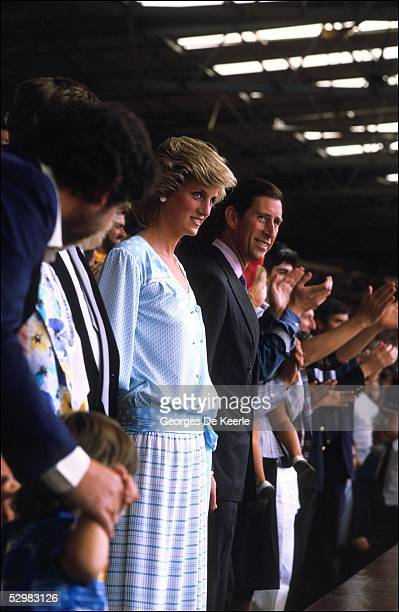 Princess Diana and HRH Prince Charles stand in the crowd during the Live Aid concert at Wembley Stadium on 13 July, 1985 in London, England. Live Aid...