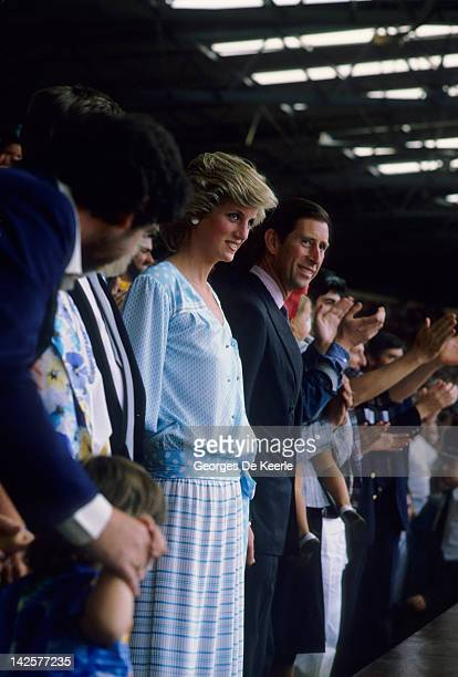 Princess Diana and HRH Prince Charles watch from the crowd during the Live Aid concert at Wembley Stadium in London 13th July 1985 The concert raised...