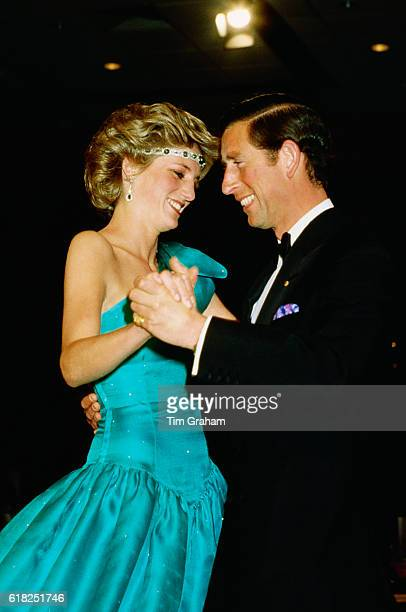 Princess Diana and Prince Charles dance at a formal event