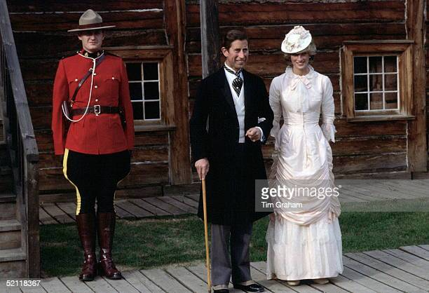 Princess Diana And Prince Charles In Klondike Style Outfits Pose Next To A Canadian Mounted Policeman During A Visit To Fort Edmonton Canada