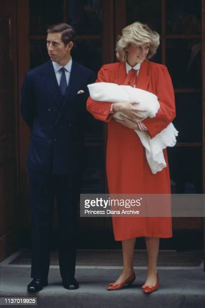 Princess Diana and Prince Charles leaving St Mary's Hospital London with their newborn son Prince Harry 16th September 1984 The Princess is wearing a...
