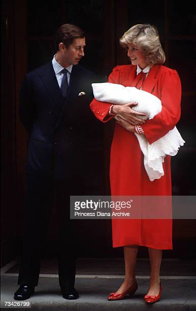 Princess Diana and Prince Charles leaving St Mary's Hospital London with their newborn son Prince Harry September 1984 The Princess is wearing a red...
