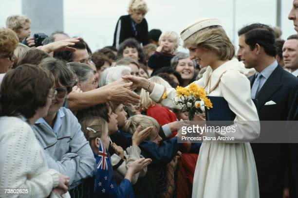 Princess Diana and Prince Charles meeting the crowd on their arrival in Auckland New Zealand 17th April 1983 The Princess wears an outfit by...