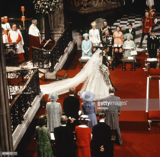 Princess Diana and Prince Charles walking down the isle being watched by both families after their wedding ceremony There were 3500 people in the...