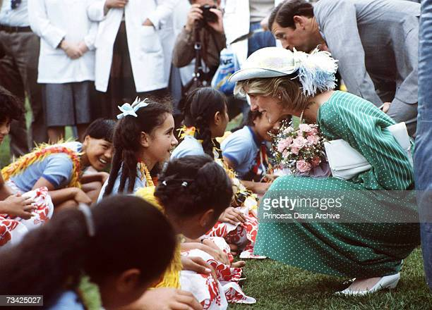Princess Diana and Prince Charles with a group of children at Auckland Stadium New Zealand for an official welcoming ceremony 18th April 1983 The...