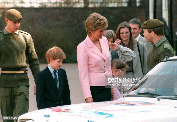 Princess Diana and Prince Harry meeting a rally team of the 2nd Battalion the Princess of Wales's Royal Regiment at Kensington Palace London April...