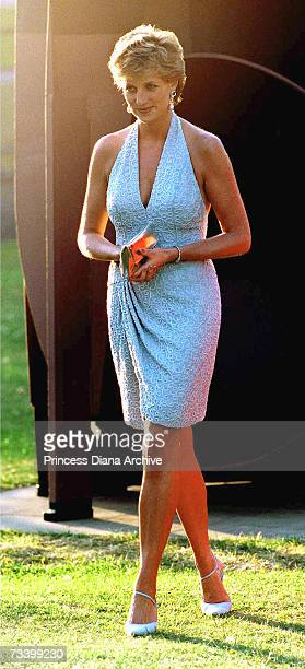 Princess Diana arrives at the Serpentine Gallery, London, June 1995. She is wearing a grey, beaded, halter-neck dress by Catherine Walker.