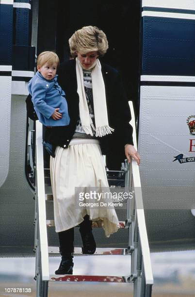 Princess Diana arrives with her son Prince Harry at Aberdeen Airport Scotland 14th March 1986 They are on their way to Balmoral
