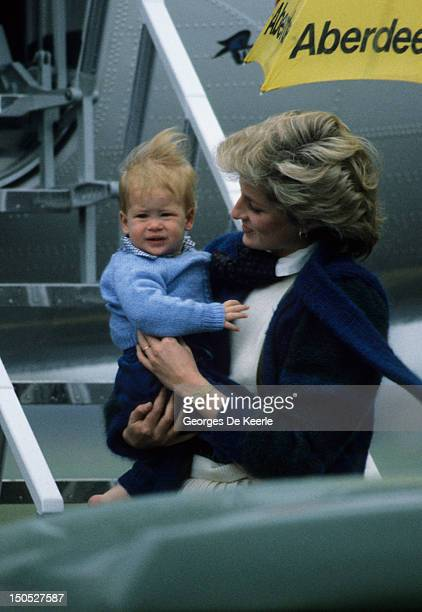 Princess Diana arrives with her son Prince Harry at Aberdeen Airport Scotland on March 14 1986 They are on their way to Balmoral