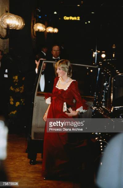 Princess Diana arriving at the Barbican in London wearing a full length red evening gown by Belville Sassoon April 1982