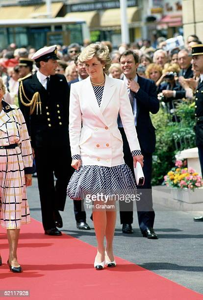 Princess Diana Arriving At The Cannes Film Festival In France Wearing A Puffball Skirt