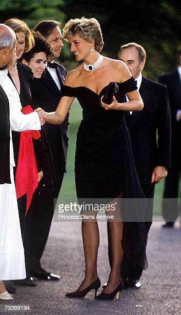 Princess Diana arriving at the Serpentine Gallery London in a gown by Christina Stambolian June 1994 Standing behind her is property developer and...