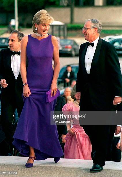 Princess Diana Arriving For Gala Dinner In Chicago In A Purple Dress Designed By Fashion Designer Versace And Shoes By Jimmy Choo.immediately Behind...
