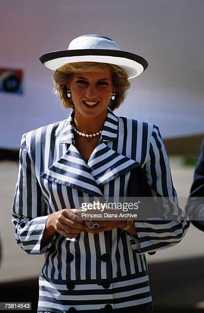 Princess Diana arriving in Lincoln wearing a striped suit and hat, July 1985.