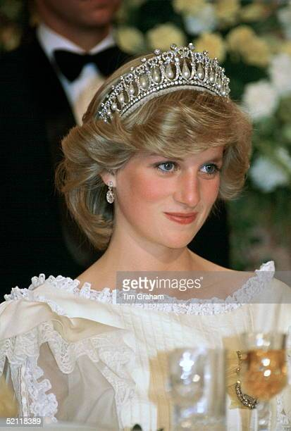 Princess Diana At A Banquet In New Zealand Wearing The Cambridge Knot Tiara With Diamond Earrings Her Cream Silk Organza Evening Dress Is Designed By...