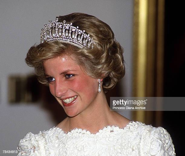 Princess Diana at a dinner at the British Embassy Washington DC November 1985 She is wearing a cream lace Murray Arbeid gown and the Queen Mary tiara